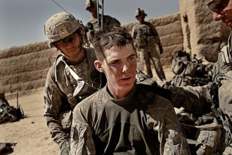 "US Infantry soldier PFC Matthew Sharpe, 19, from 1st Platoon, Alpha Company, 2nd Battalion, 502nd Infantry Regiment, 2nd Brigade, 101st Airborne Division, receives medical treatment from fellow soldiers after two IED  (Improvised Explosive Device) attacks during  ""Operation Clarksville"" in Zhari District of Kandahar Province, Afghanistan on Oct. 9, 2010.  The two house-born IED blasts occurring 5 minutes apart while US troops secured a compound, injured several soldiers and caused the entire platoon became ""combat ineffective"" which forced the platoon to evacuate and seek medical attention at Howz-e-Medad Forward Operating Base.  US-led ""Operation Clarksville"" began in Zhari district in mid-October with combat missions aiming to provide security to the local population while clearing the area of IEDs and Taliban insurgents; parts of Zhari district are new terrain for US forces.  Within the first 72 hours of the operation Alpha Company alone experienced 4 IED attacks, which is the main weapon used by the Taliban and the cause of 80% of the Battalion's casualties."
